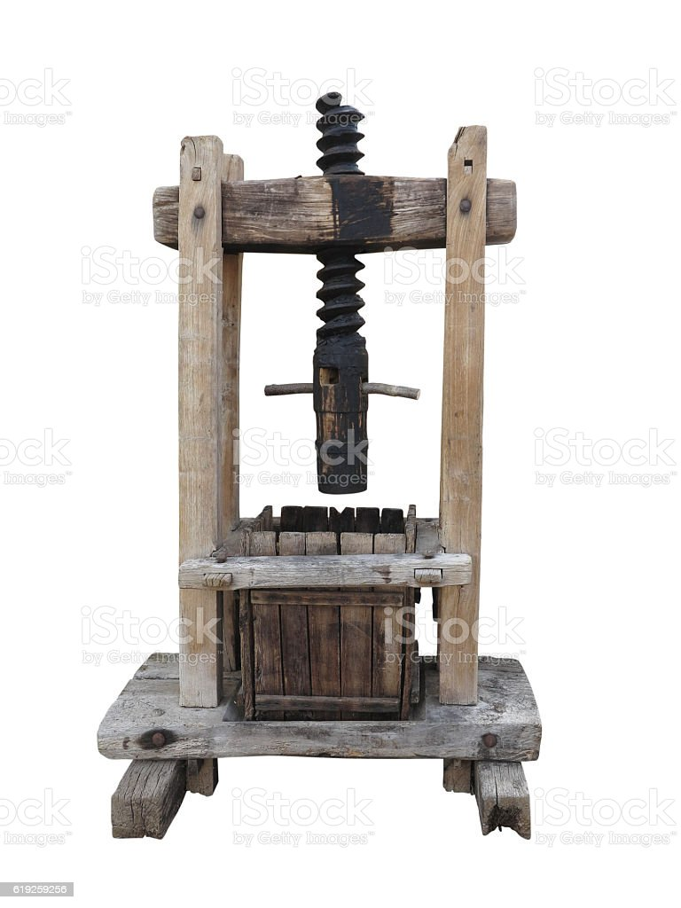 Ancient wooden wine old press isolated on white stock photo