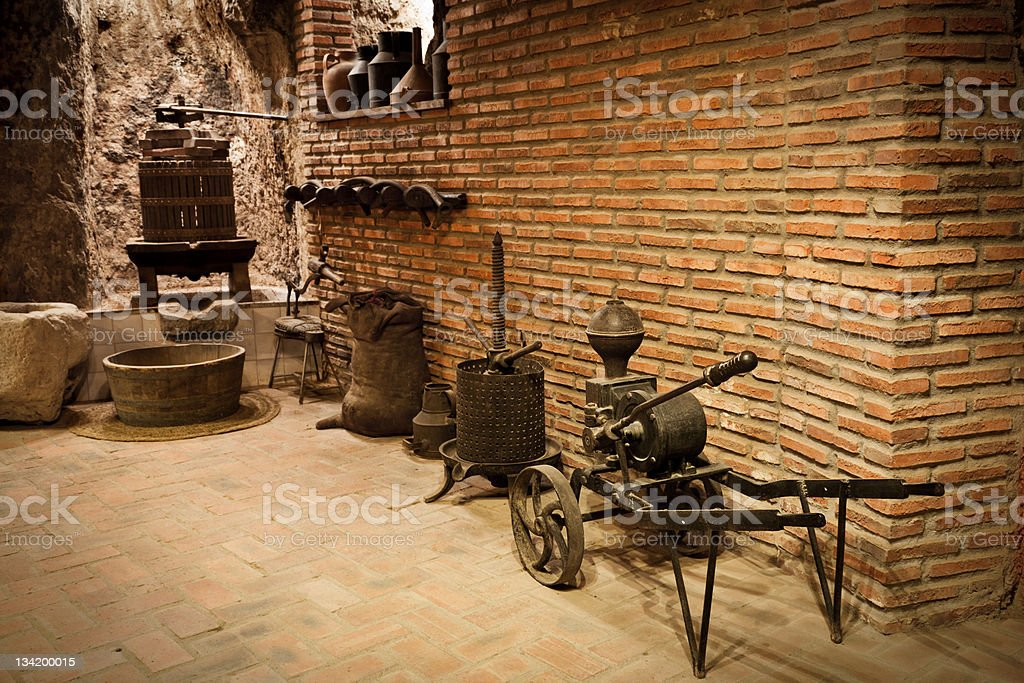 Ancient work tools to make wine inside a cellar royalty-free stock photo