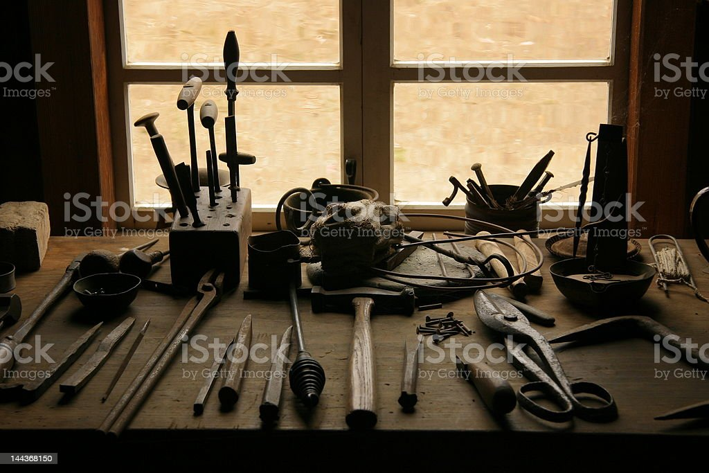 Ancient Workbench and Tools stock photo