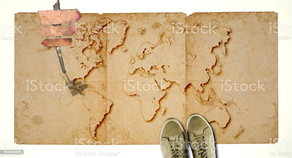 Ancient world map with blank wooden sign and sneakers. Travel. stock photo