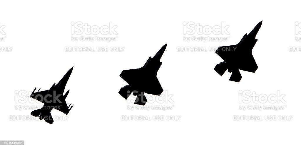 F-16 and 2 F-35 Lightning (silhouette) stock photo