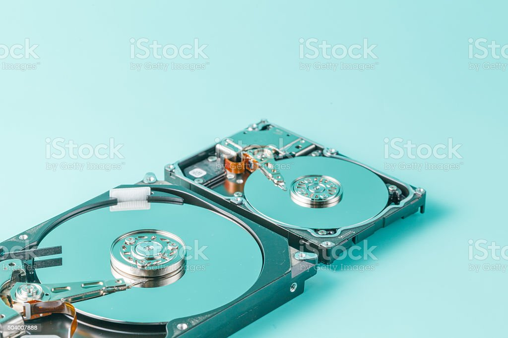 3,5' and 2,5' hard disk drives opened stock photo