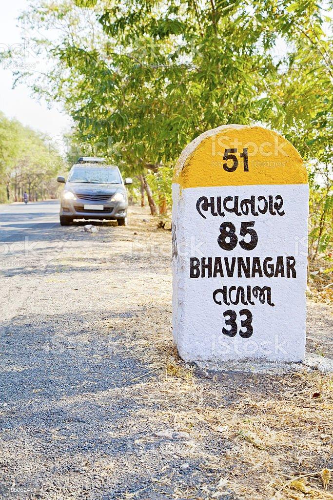 MPV and 85 kilometers to Bhavnagar milestone royalty-free stock photo