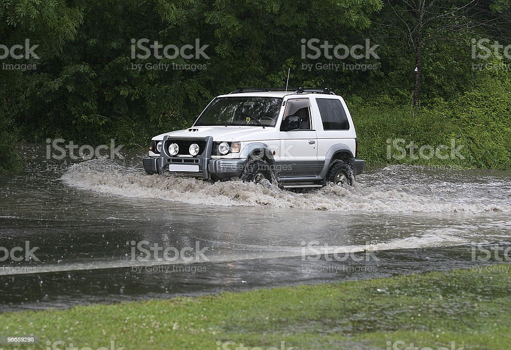 SUV and a flood stock photo