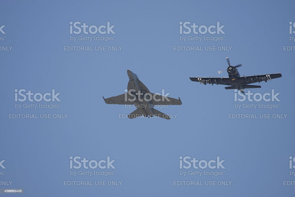F-16 and A-1 Skyraider In Flight stock photo