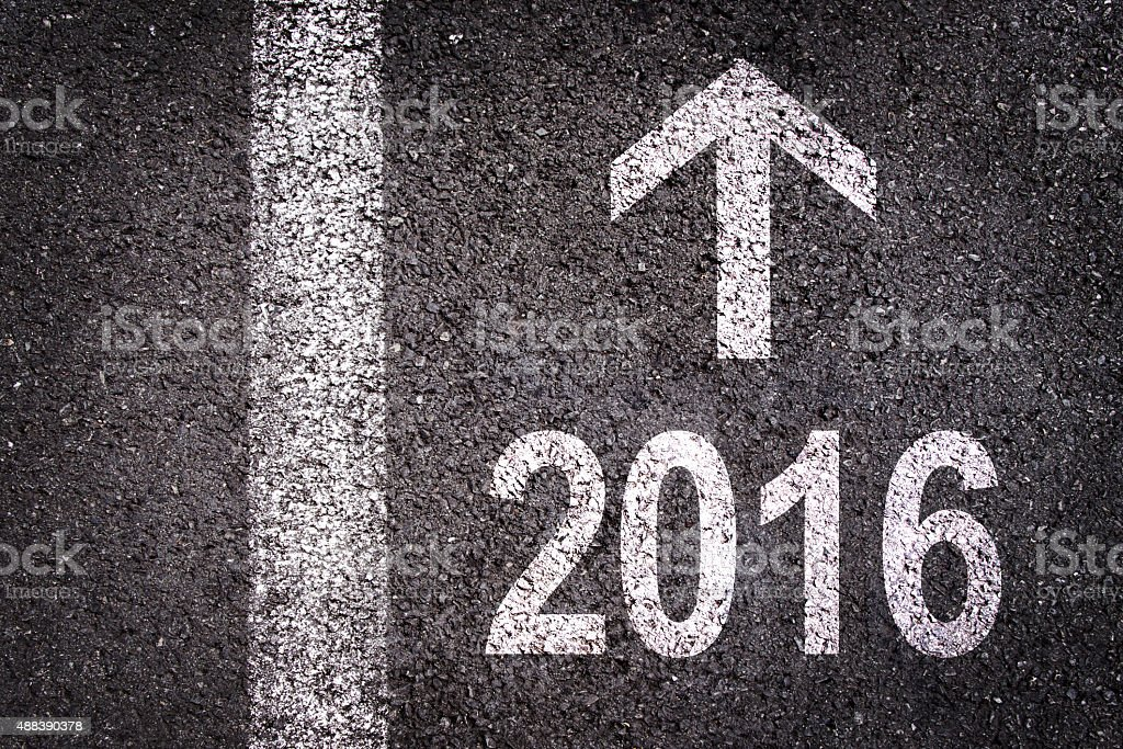 2016 and an arrow written on an asphalt road background stock photo