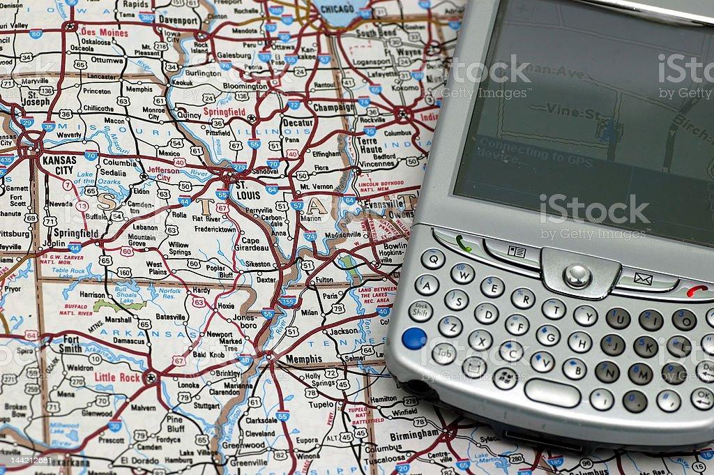 GPS and Atlas royalty-free stock photo