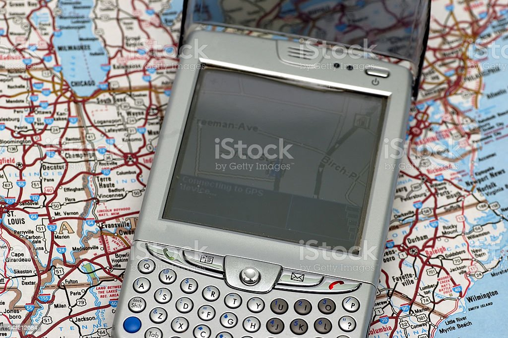 GPS and Atlas royalty-free stock photo