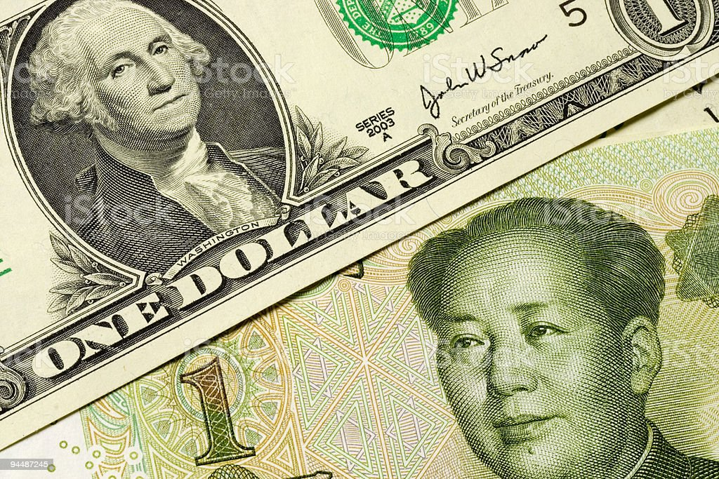 US and Chinese currency stock photo