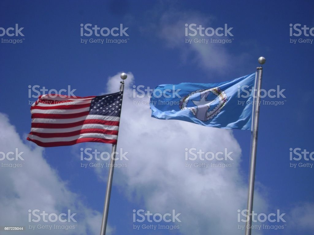 US and CNMI flags stock photo
