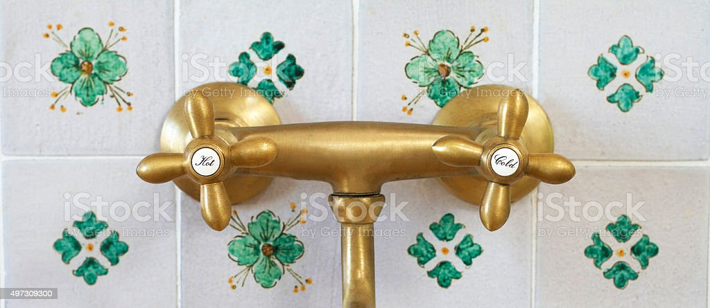 HOT and COLD: Vintage European Water Knobs, Tile Backsplash stock photo