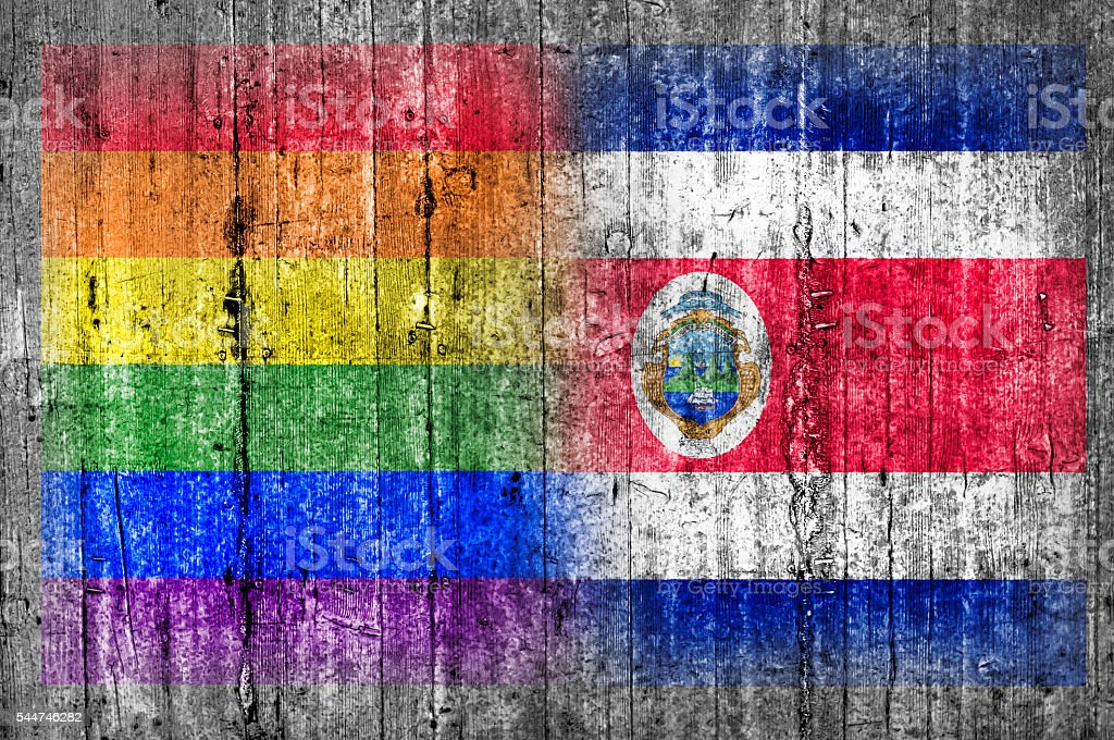 LGBT and Costa Rica flag on concrete wall stock photo