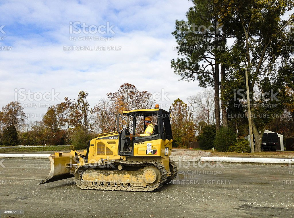 CAT D5K and Driver royalty-free stock photo