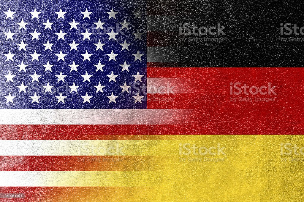 USA and Germany Flag painted on leather texture stock photo