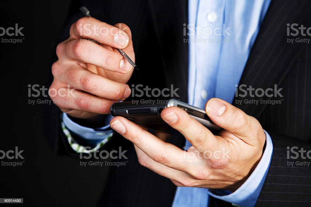 PDA and hands - close up royalty-free stock photo