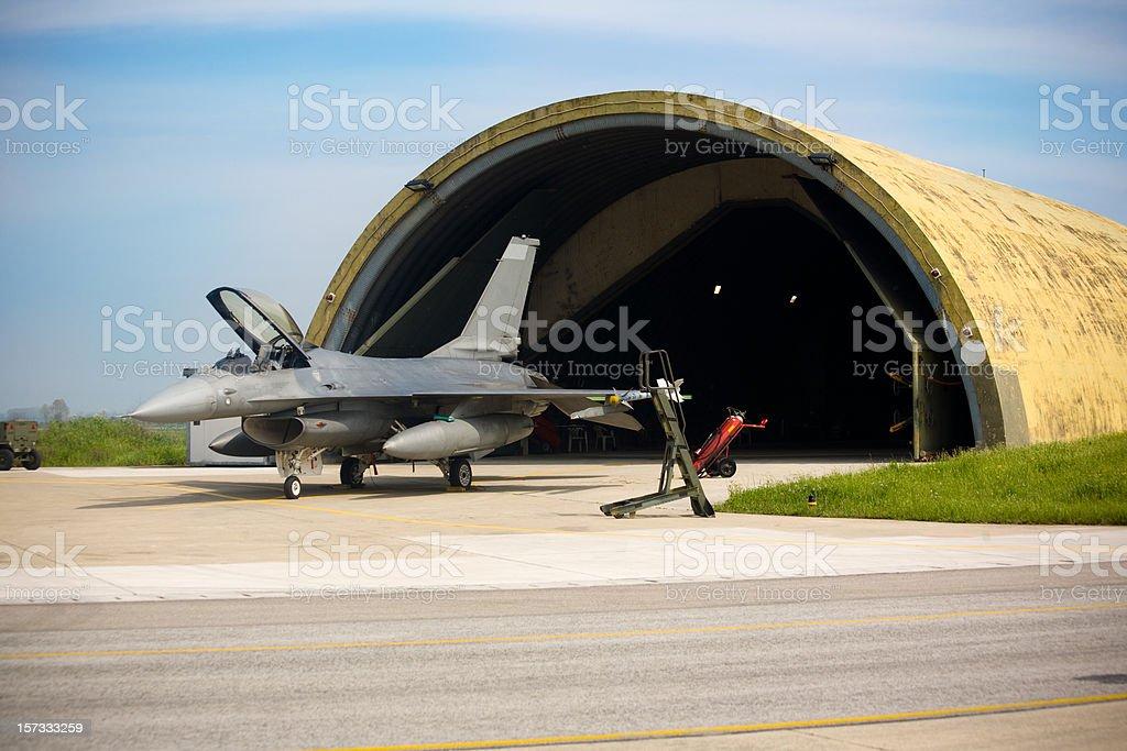 F16 and Hangar royalty-free stock photo