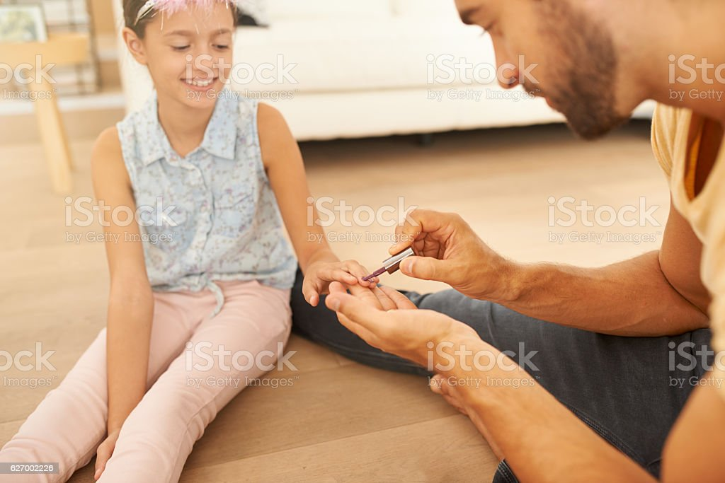 And he paints nails too! stock photo