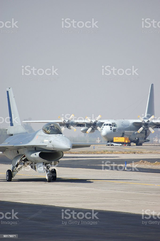 F-16 and Hercules stock photo