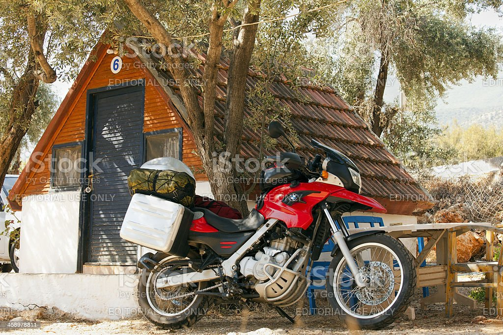 BMW F650 GS and in front of bungalow stock photo