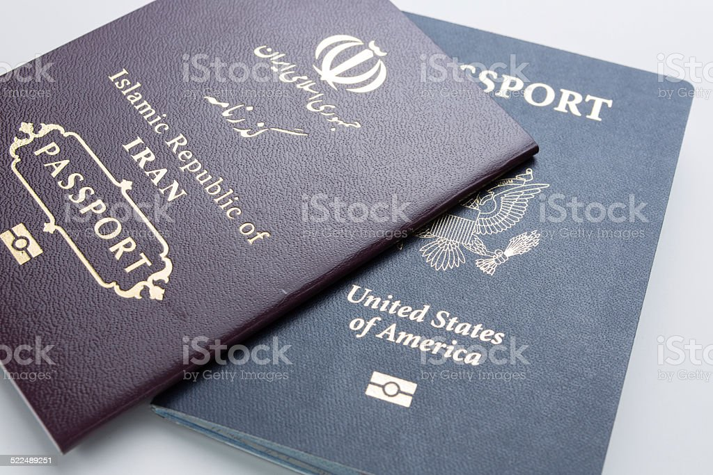 U.S. and Iranian passport stock photo