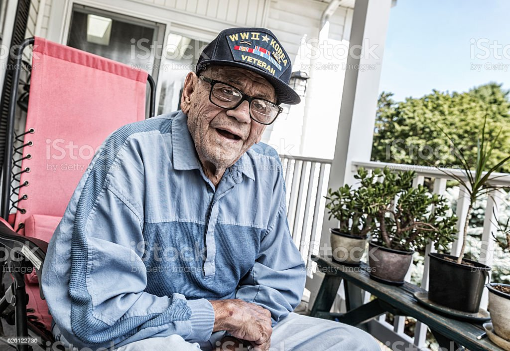 WWII And Korea Conflict USA Military Veteran Listening stock photo
