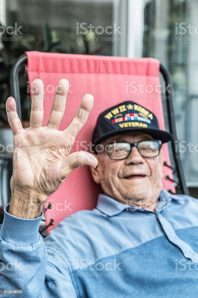 WWII And Korea Conflict USA Military Veteran Waving Hand stock photo