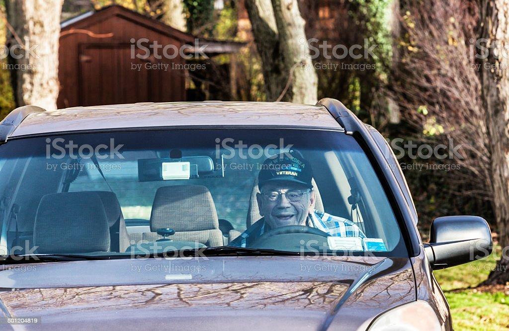 WWII and Korean War Military Veteran Driving Car stock photo