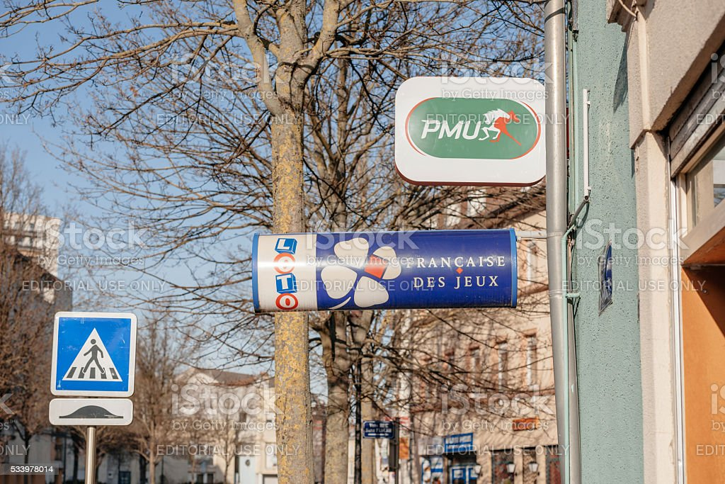 PMU and LOTO de France lottery signs stock photo