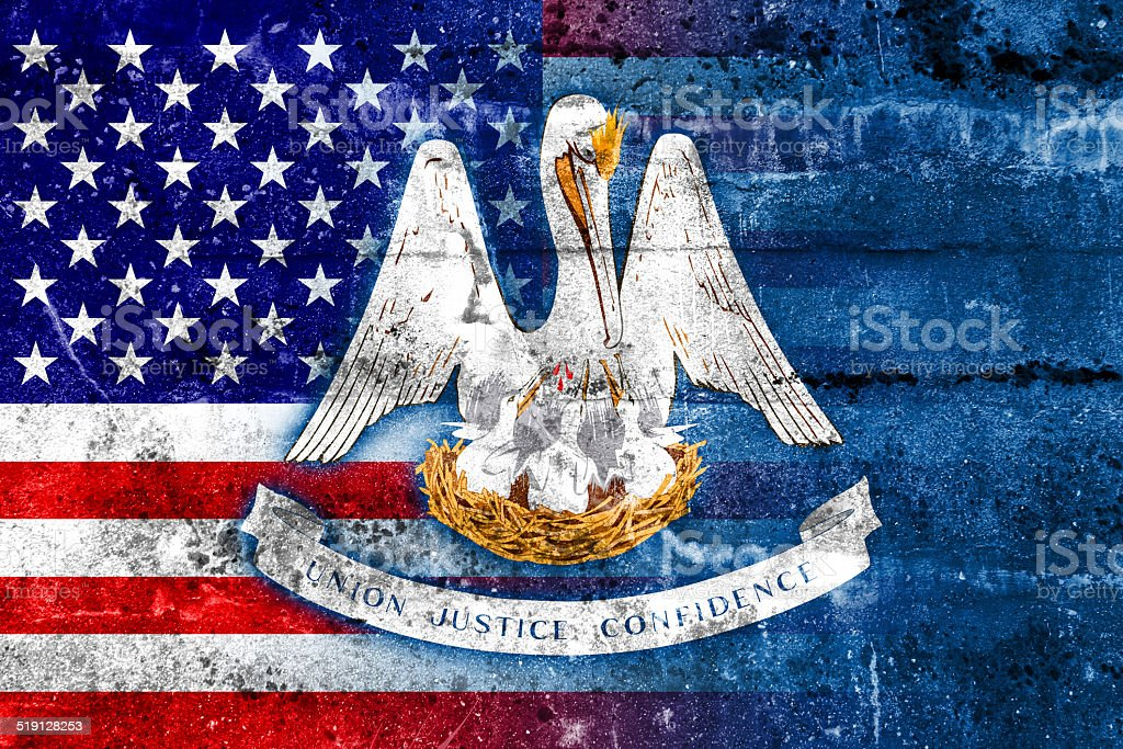 USA and Louisiana State Flag painted on grunge wall stock photo