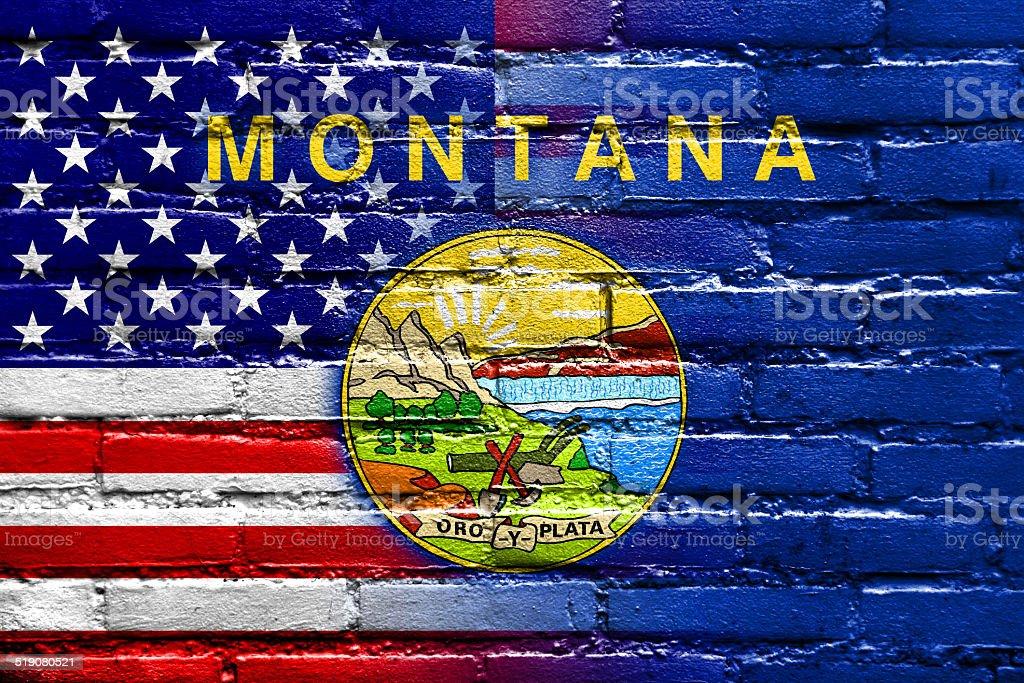 USA and Montana State Flag painted on brick wall stock photo