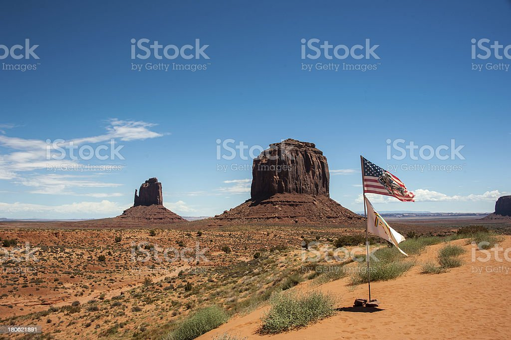 USA and Navajo Flags against Monument Valley royalty-free stock photo