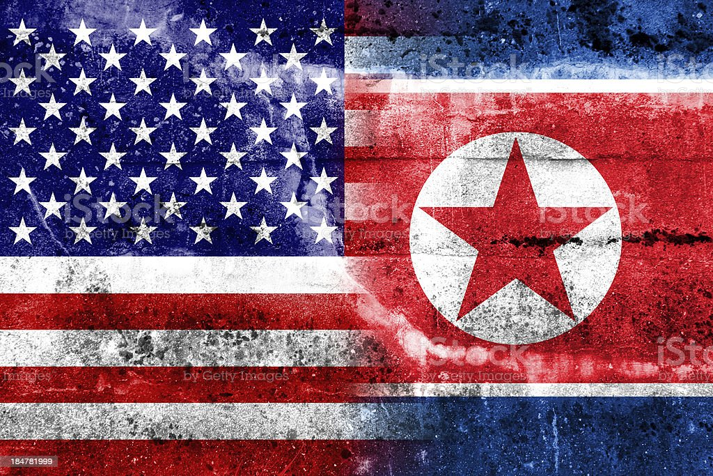 USA and North Korea Flag painted on grunge wall royalty-free stock photo