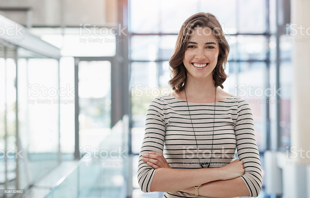 Portrait of a confident businesswoman working in an...