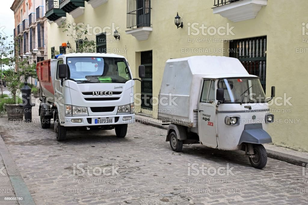 IVECO and Piaggio vehicles on the street stock photo