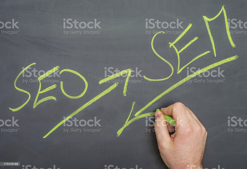 SEO and sem written on blackboard with hand Suchmaschinenoptimierung Suchmaschinenmarketing stock photo