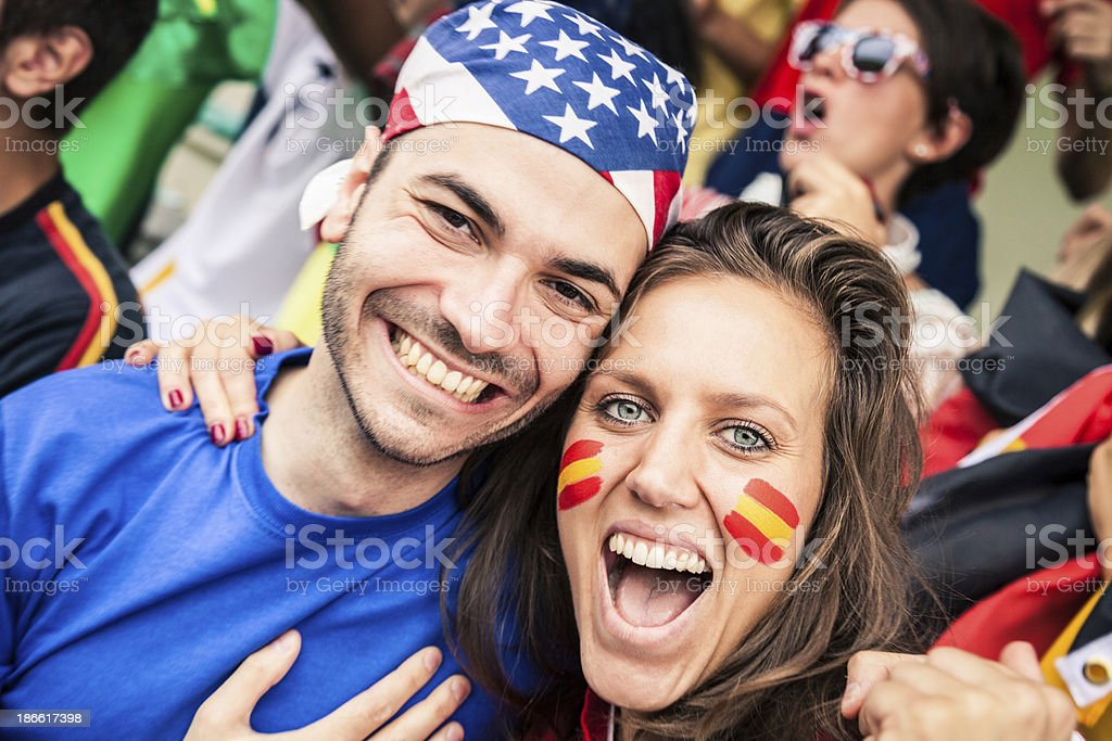 USA and Spain fans together royalty-free stock photo