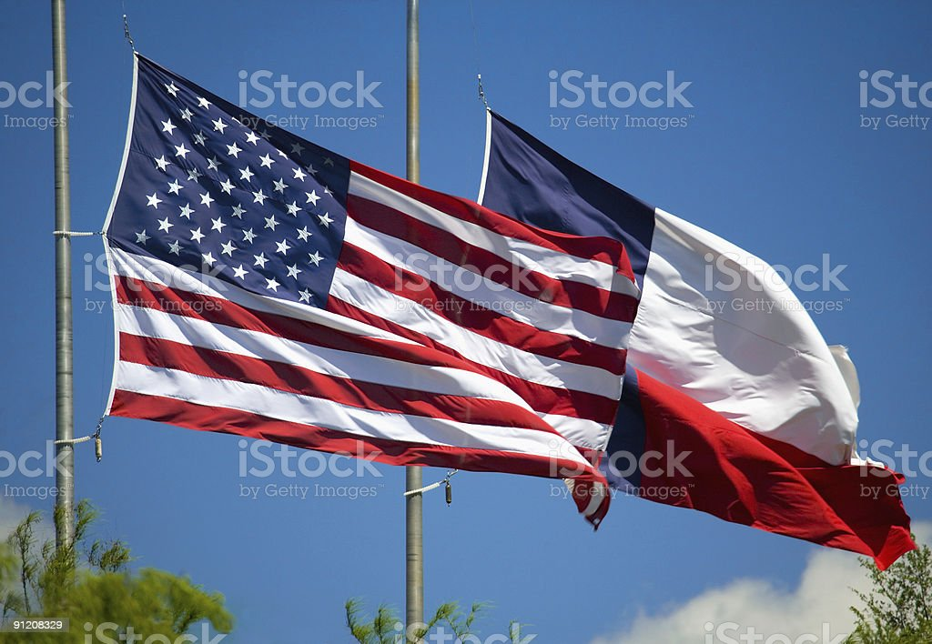 US and Texas Flags flying at half mast stock photo