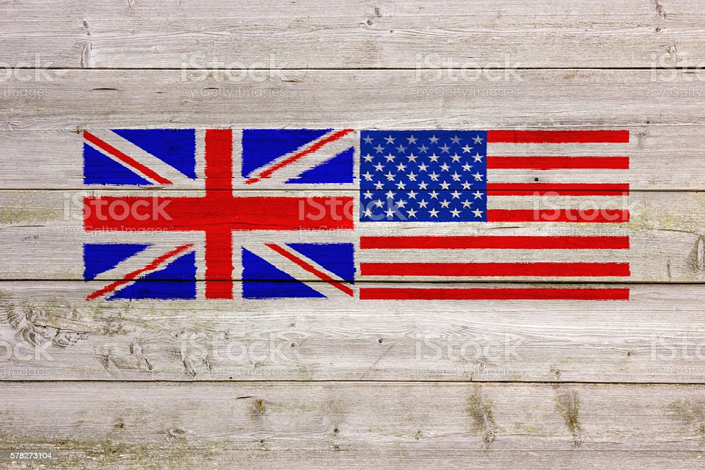 USA and UK Flags Painted On Wooden Wall stock photo