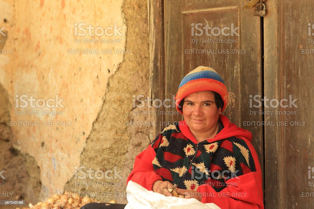 Andean Lady Works with Onions Seeds stock photo