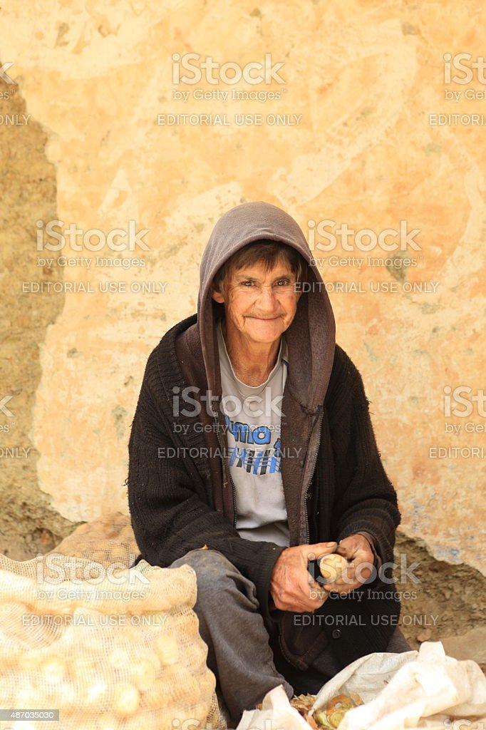 Andean Mature Lady Works with Onions Seeds stock photo
