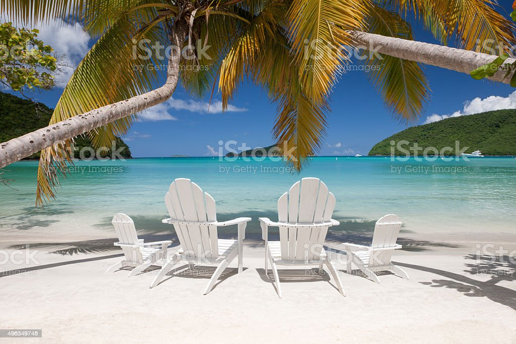 andirondack chairs on a beach at Maho Bay, St.John, USVI stock photo