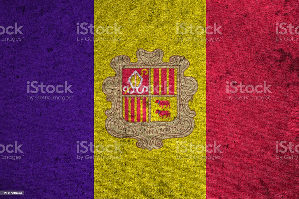 andorra flag on an old grunge background stock photo