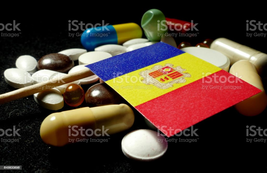 Andorran flag with lot of medical pills isolated stock photo