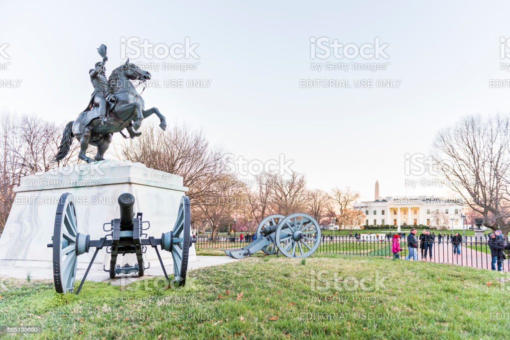 Andrew Jackson memorial in front of white house with cannons at sunset stock photo