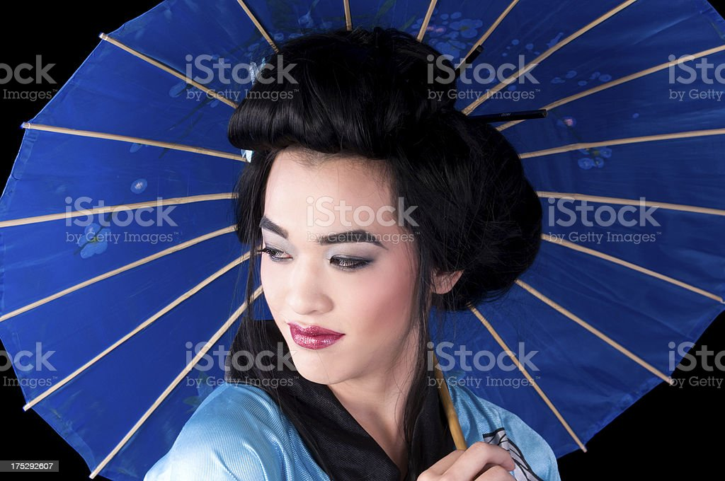 Androgynous Asian male as Geisha looking away. royalty-free stock photo