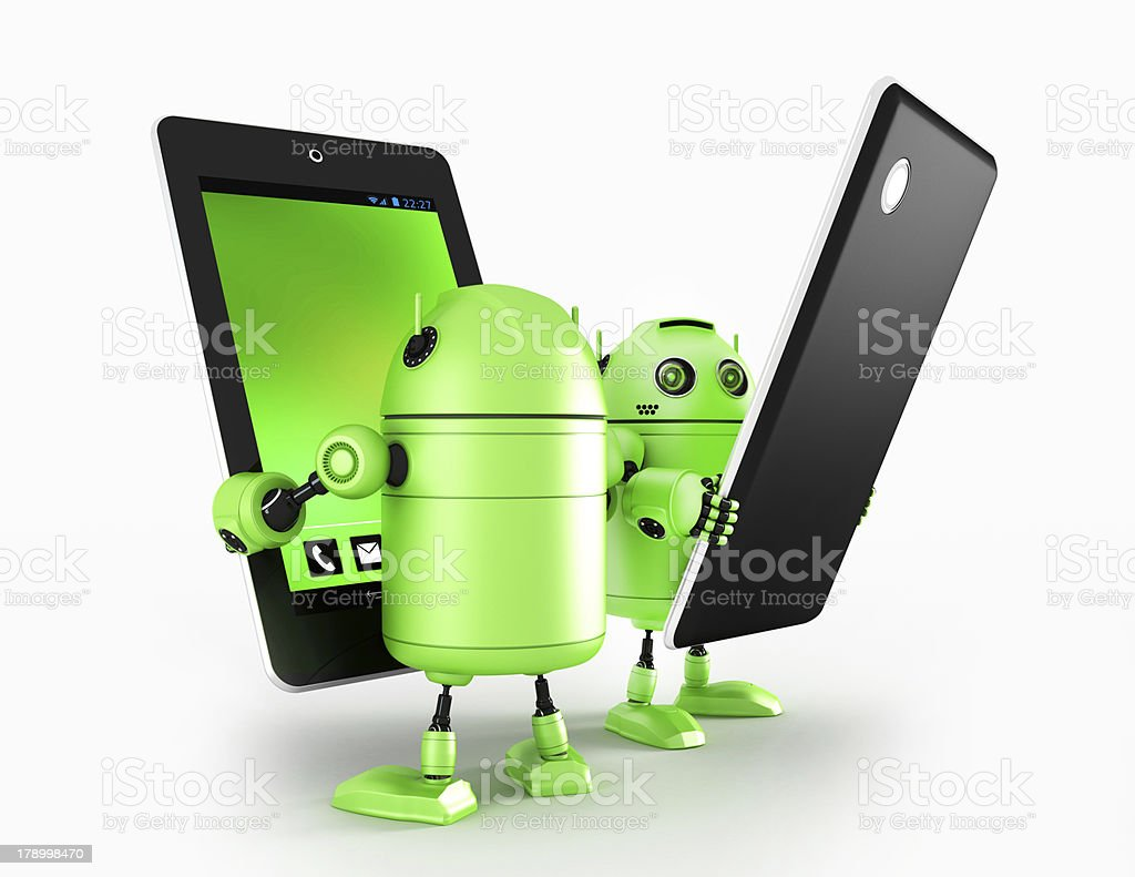 Androids with tablet stock photo