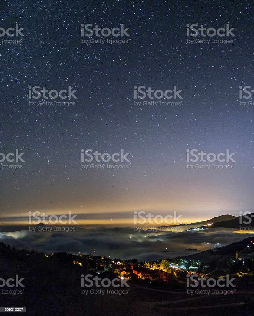 Andromeda Galaxy Over the Clouds stock photo