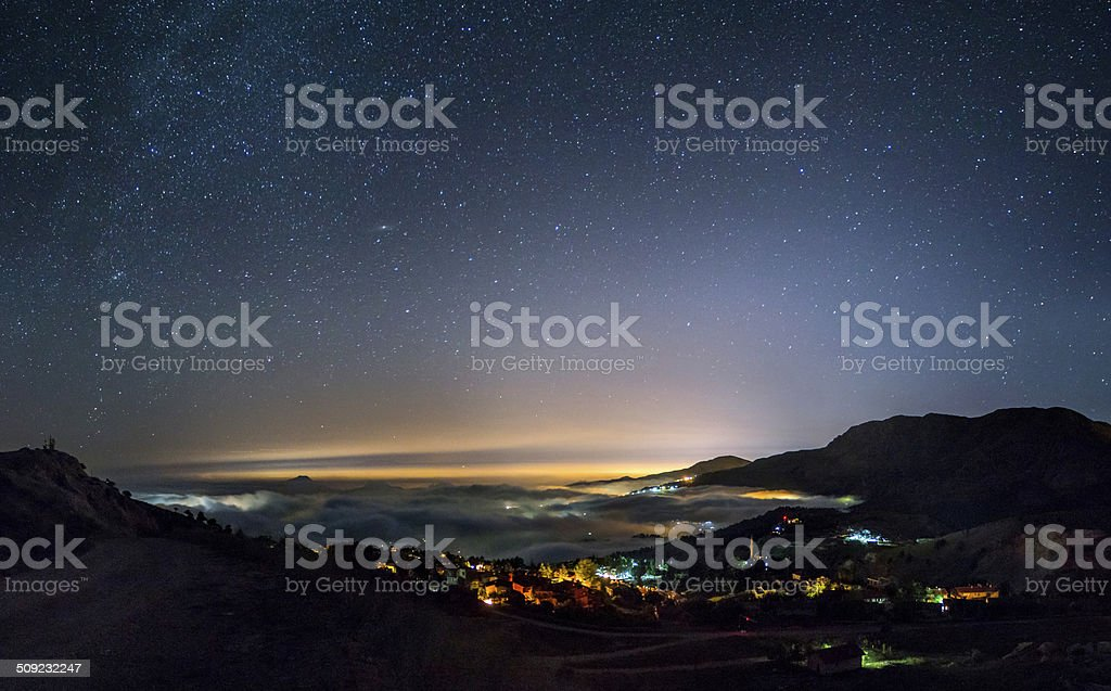 Andromeda Galaxy Over the Clouds royalty-free stock photo