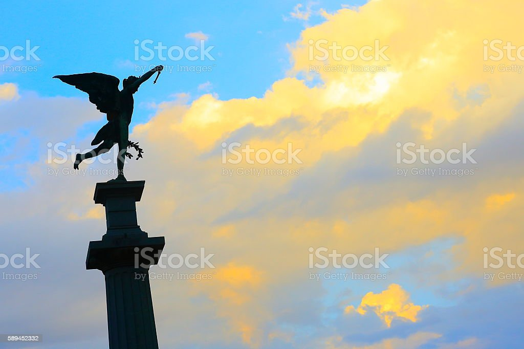 Angel and Crown of Victory, dramatic sunset, Recoleta cemetery stock photo