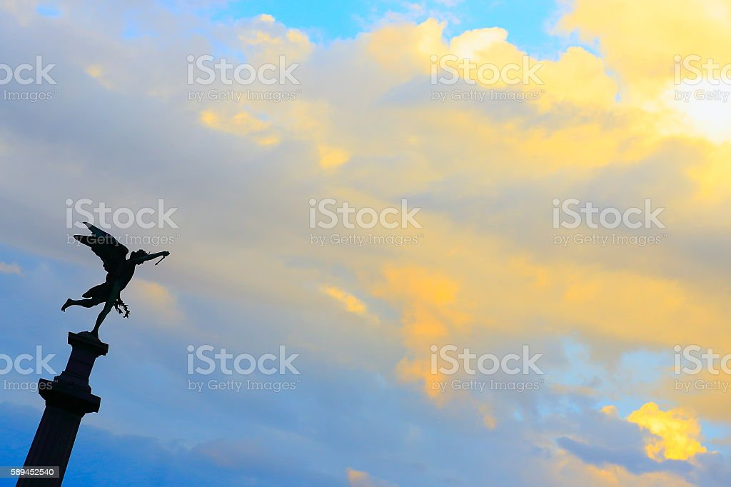 Angel and Crown of Victory Laurel Wreath, dramatic sunset, Recoleta stock photo